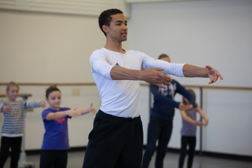 NYCB dancer Silas Farley leading a workshop for children. Photo Rosalie O'Connor